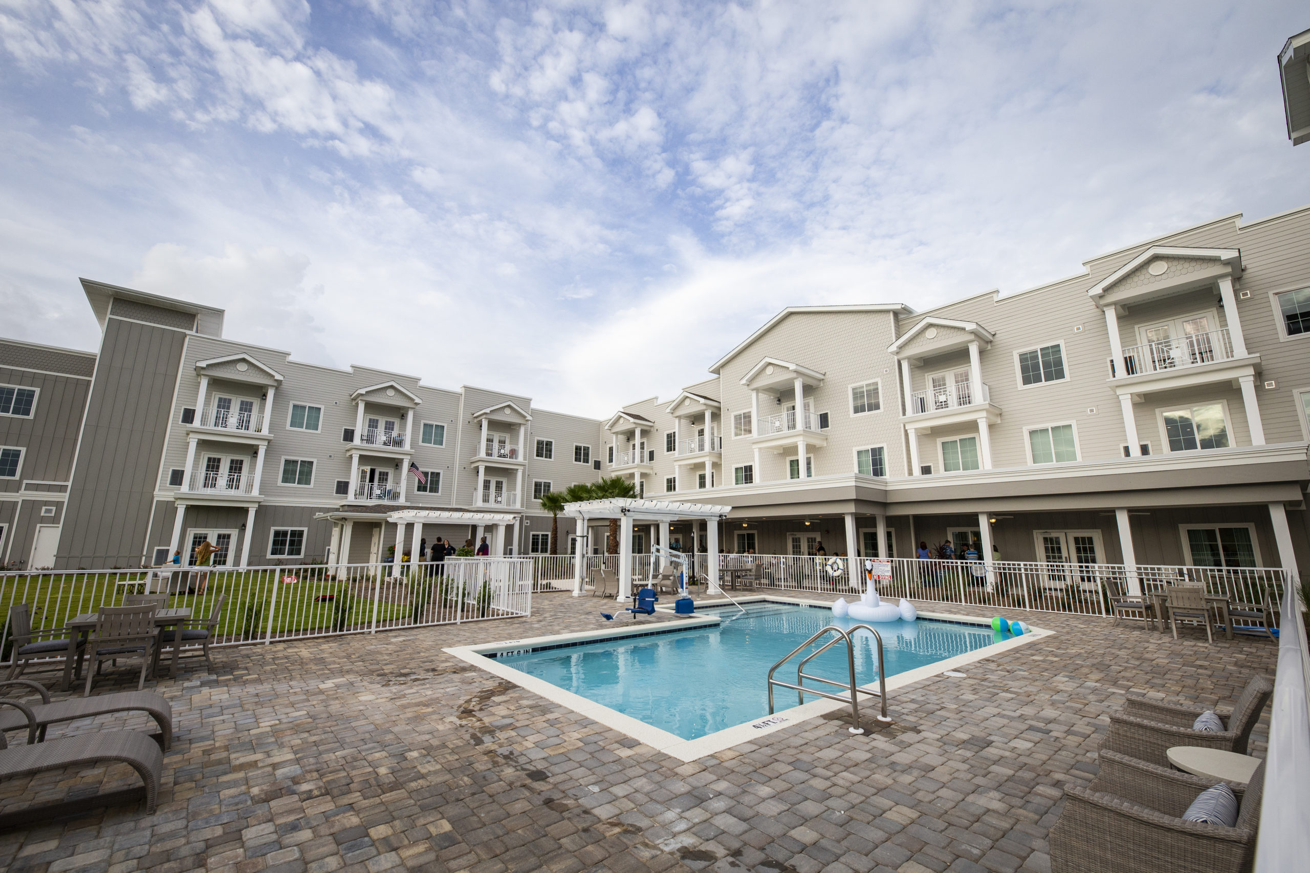 View of swimming pool at Seagrass Village of Panama City Beach a 55+ independent living community for seniors