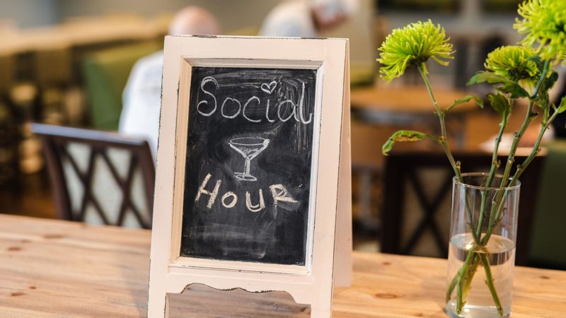 Chalkboard sign with Social Hour written on it