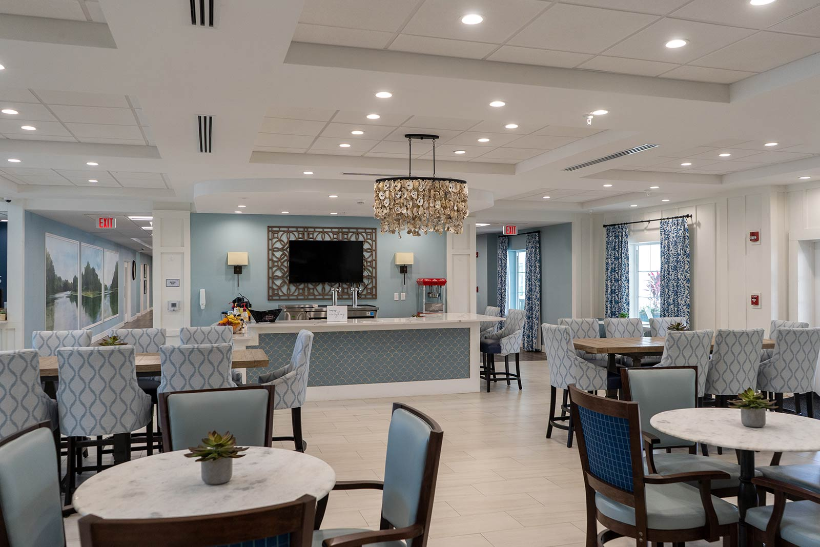 Restaurant-style Dining Room With Tables And Chairs At Seagrass Village Of Panama City Beach