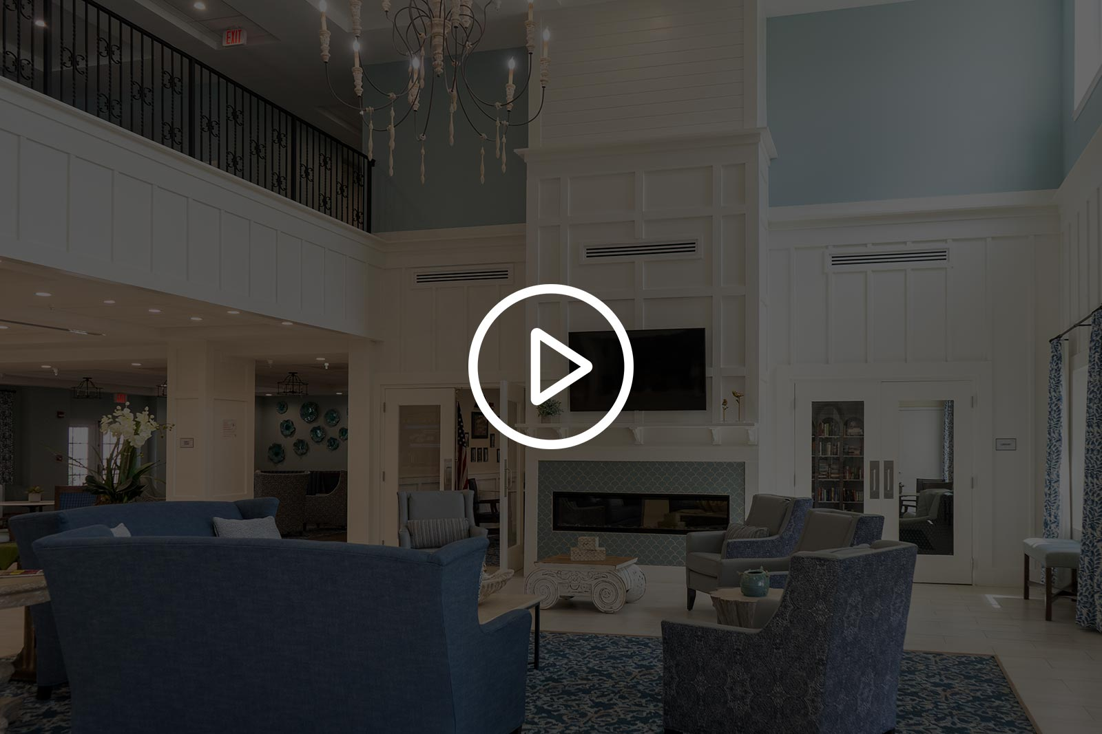 Gathering Area With Fireplace, TV, Couches And Chairs At Seagrass Village Of Panama City Beach