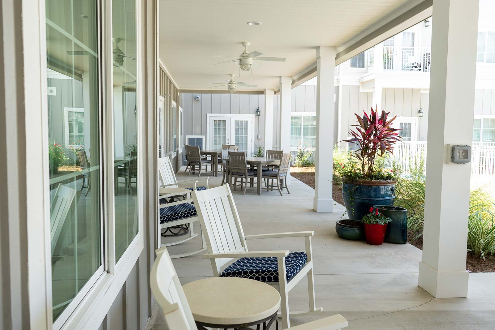 Covered Patio With Chairs And Tables At Seagrass Village Of Panama City Beach