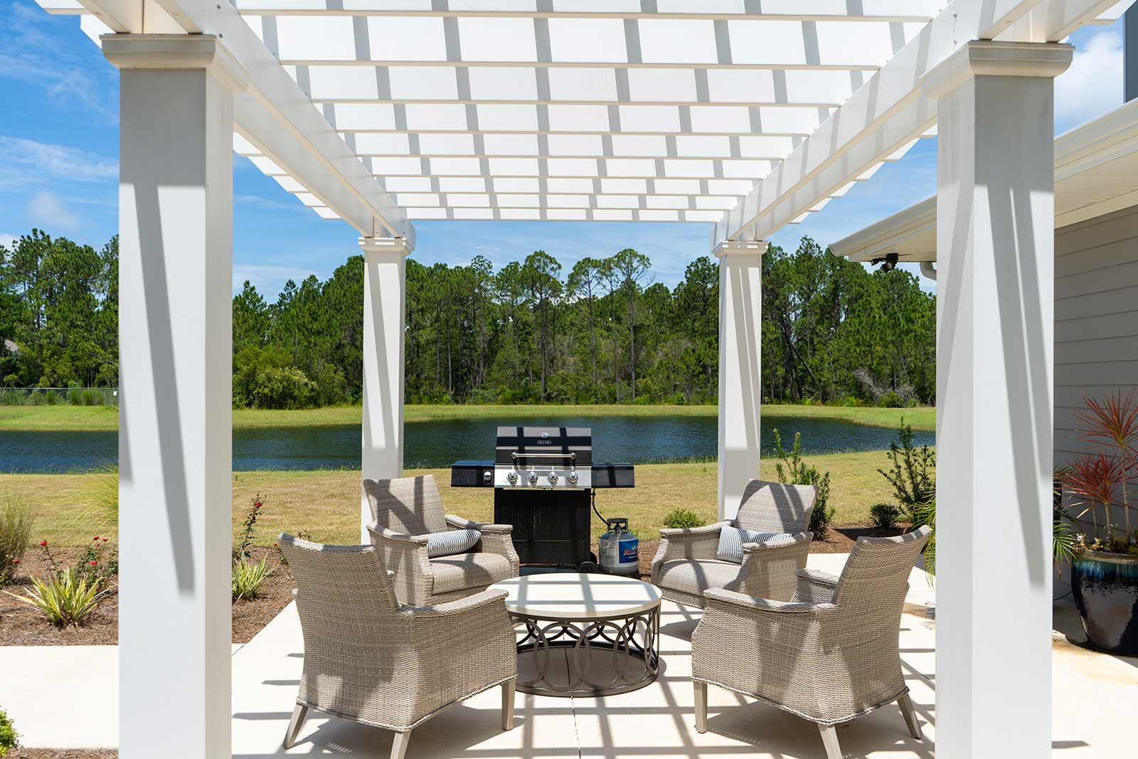 Grill And Patio Furniture Under Pergola At Seagrass Village Of Panama City Beach