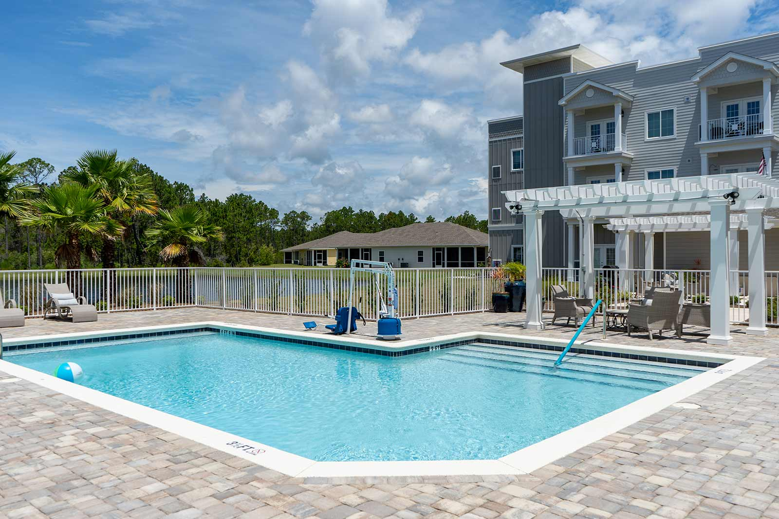 Large Swimming Pool With Deck Chairs At Seagrass Village Of Panama City Beach